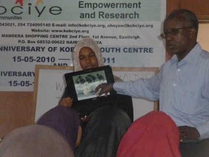The author's sister Kaltum, and their late father, Abdullahi Hassan Eyow, at a workshop last summer.