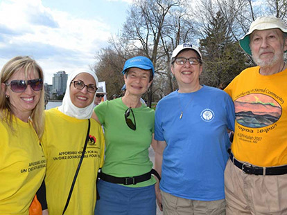 Maha Sakka, MHI's Fundraising Manager, with supporters of MHI