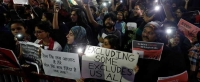 Student protesters hold signs in New Delhi