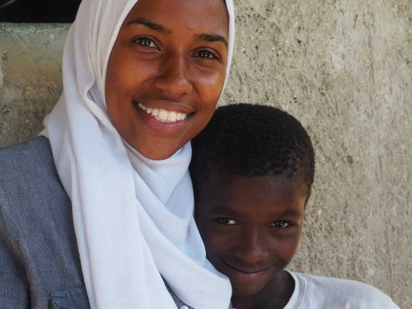Haitian Canadian Fatima Estime with one of her students in the village of Desab, Haiti