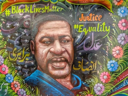 Pakistani truck artist painted a mural depicting George Floyd surrounded by a colorful heart-shaped garland of flowers, with slogans such as #Black Lives Matter on one side and #justice and #equality on the other.