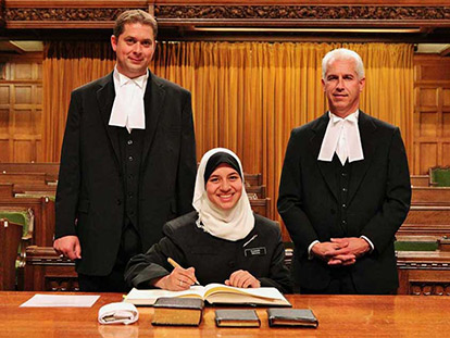 Parliamentary Page Yasmeen Ibrahim at her Swearing-In Ceremony. All Parliamentary personnel, including MPs, Clerks, Pages are expected to swear an oath to act in Her Majesty the Queen's best interests, before they are allowed to work in the House of Commons.