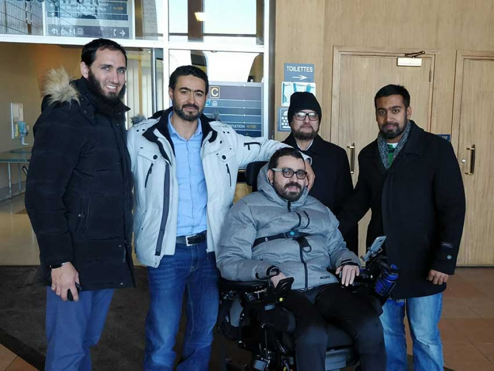 Shaikh Daood Butt with Aymen Derbali and community members in Quebec City. Contribute to help support Aymen's recovery.