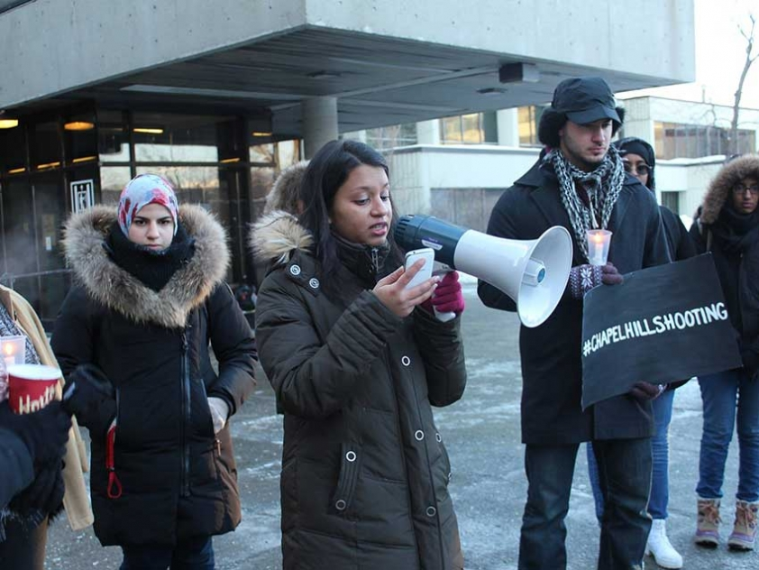 Tabitha Mirza speaking at the University of Ottawa Vigil for the victims of the Chapel Hill Shooting.