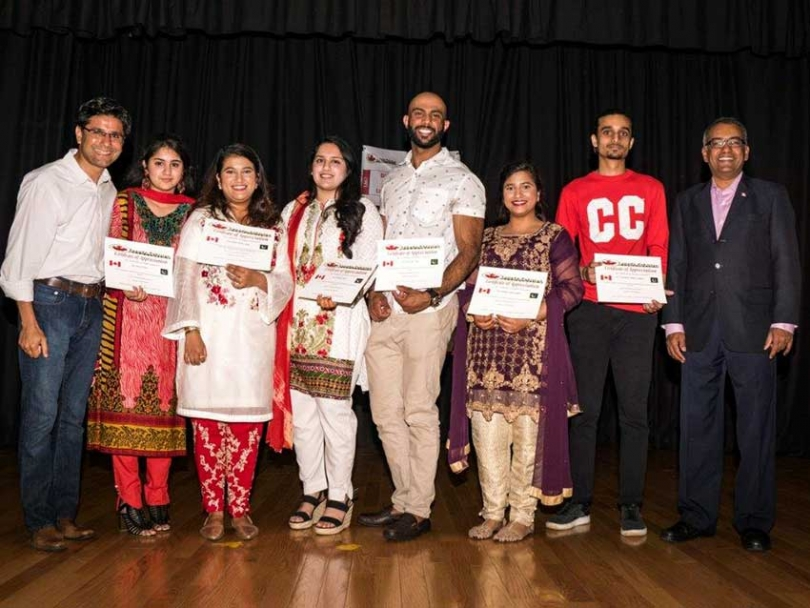 Pakistani Canadian community members receive awards of recognition at the Canada Pakistan Association's Canada Day Celebration in Ottawa.