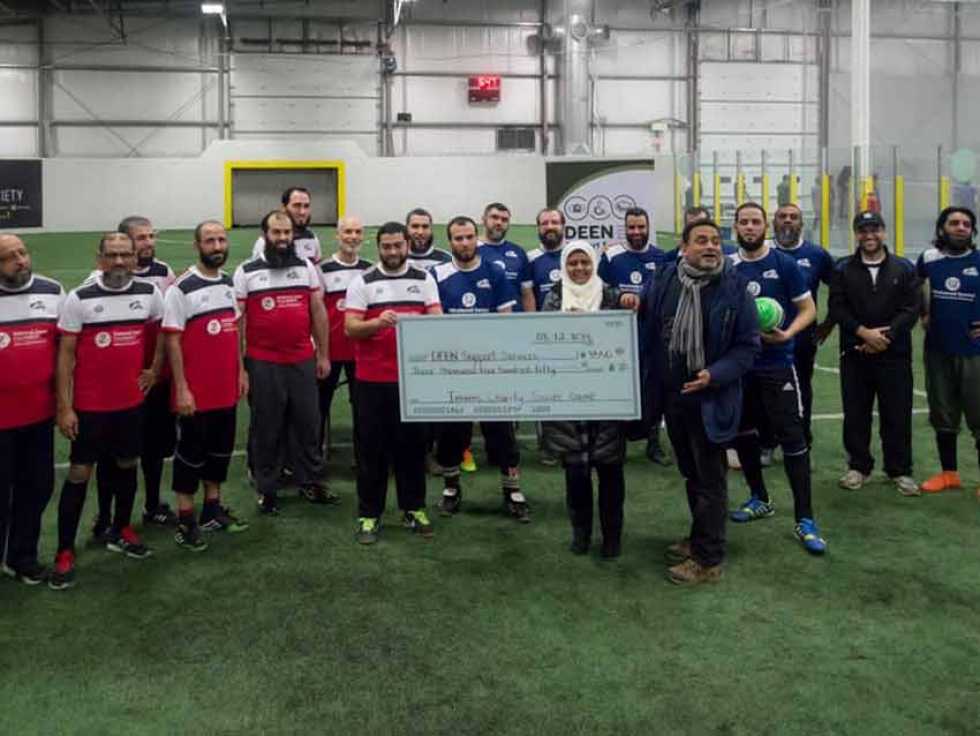 Imams presenting a cheque to Deen Support Services at the 2018 Imams Charity Soccer Game in Mississauga, Ontario.