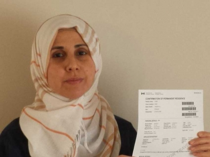 Dima Siam, a refugee from Syria, finally receives Canadian permanent resident status.