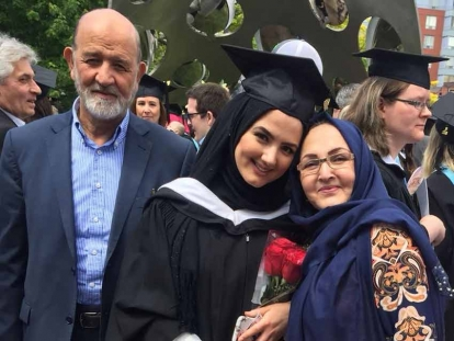 Sadaf Parweez with her parents at her UOIT graduation in June.