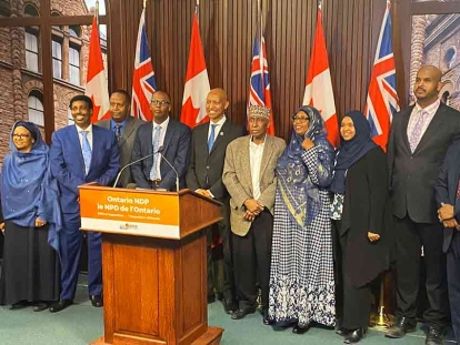 NDP MPP Faisal Hassan and members of Toronto's Somali community at a press conference on March 10, 2020
