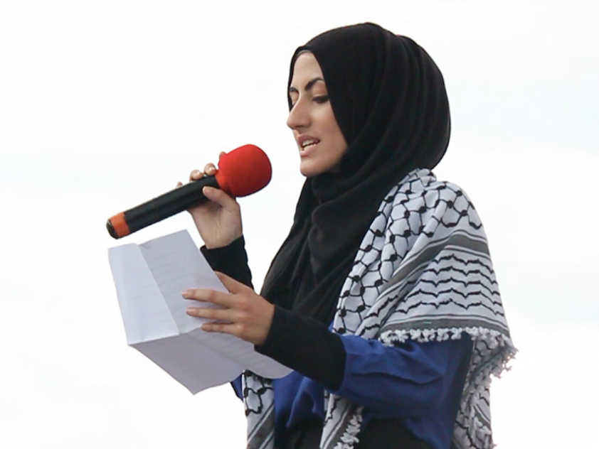 Haneen Al-Hassoun performing a poem at a demonstration in solidary with the people of Gaza July 2014