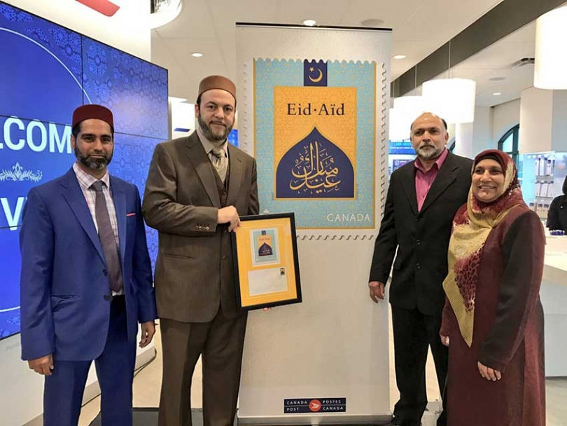 Imam Hamid Slimi and Muslim community members at the launch of Canada Post's Eid Stamp in Richmond Hill, Ontario.