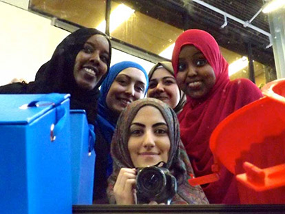 Volunteers with Carleton University's Muslim Students' Association take a photo using a mirror during their World Hijab Day event.