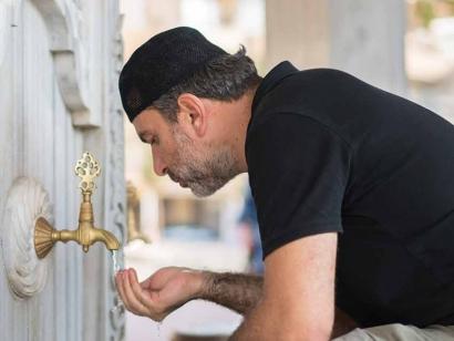 A Muslim man prepares for prayer by doing a ritual washing.