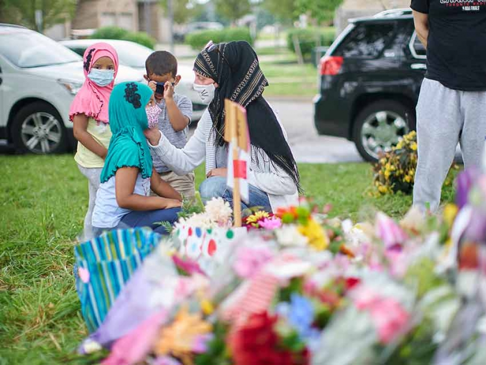 Mourners gather at the scene of the hate-motivated vehicle attack in London, Ont., which left four members of a Muslim family dead and sent their youngest son to hospital.