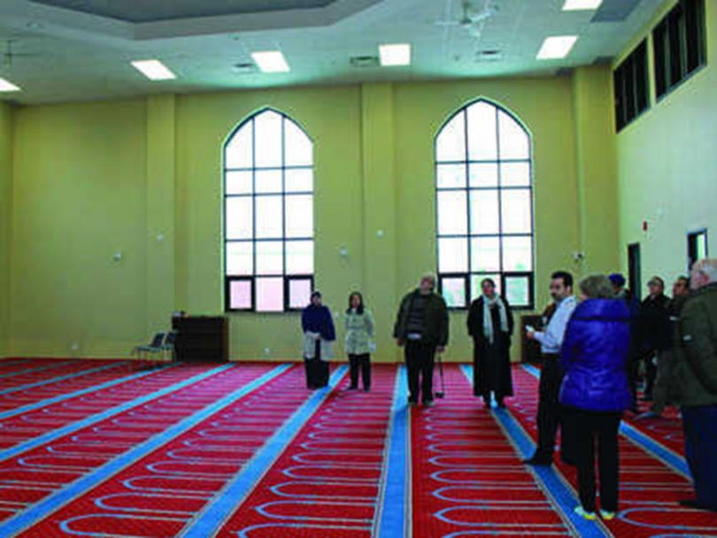 Participants on the Sustainability Bus Tour learn about the Bilal Mosque's green features.