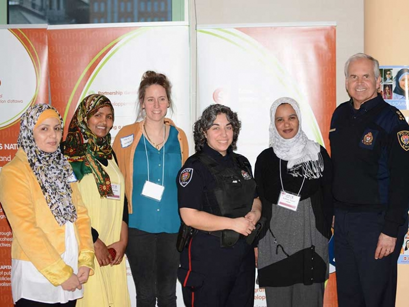 Afghan women's rights activist Sadiqa Basiri (far left) spoke at Ottawa Hijab Solidarity Day along with with Ottawa Police Chief Charles Bordeleau.