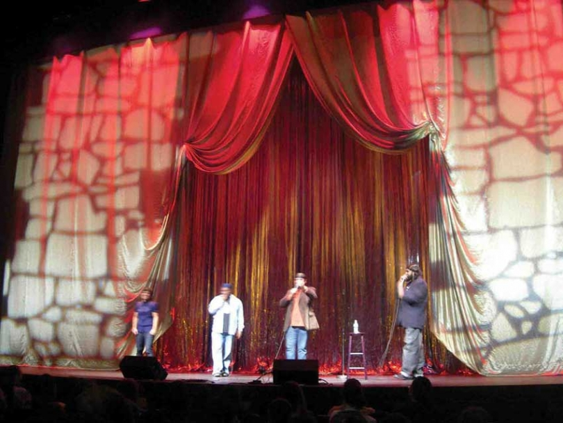 Stand-up comedians perform on stage at the annual MuslimFest.