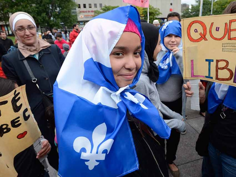 Demonstrators take part in a protest against Quebec's proposed Values Charter in Montreal in September 2013.