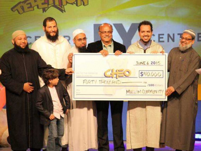 Local imams and leaders of Muslim organizations presenting CHEO with a donation on behalf of Ottawa's Muslim Community in 2016