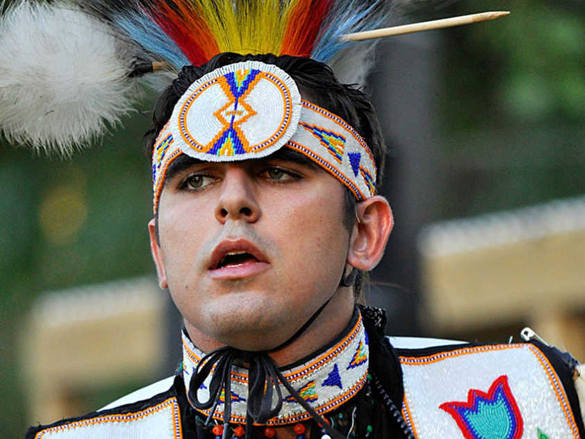 Shady Hafez in men's traditional regalia at a Pow Wow.