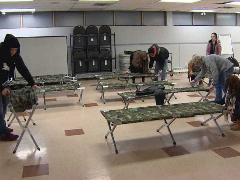 Volunteers set up the overnight space at Al Rashid Mosque in Edmonton, Alberta