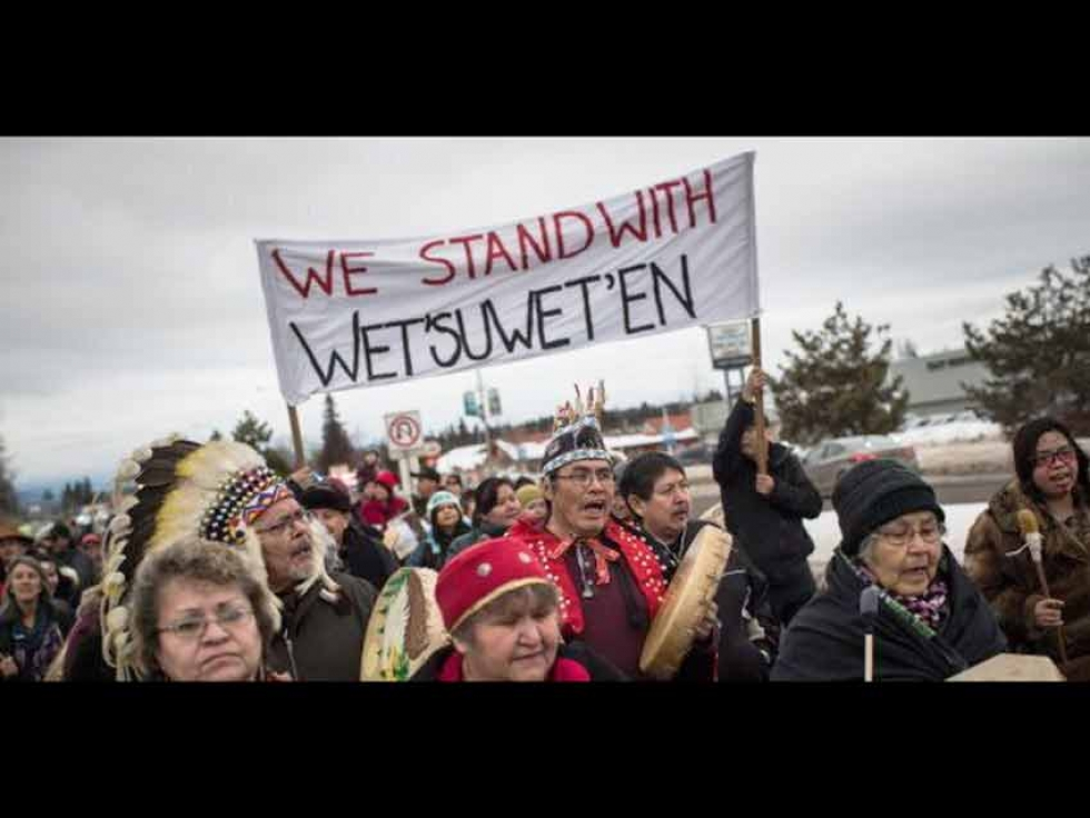 Hereditary Chief Ronnie West, centre, from the Lake Babine First Nation, sings and beats a drum during a solidarity march after Indigenous nations and supporters gathered for a meeting to show support for the Wet'suwet'en Nation, in Smithers, B.C., on Jan. 16, 2019.