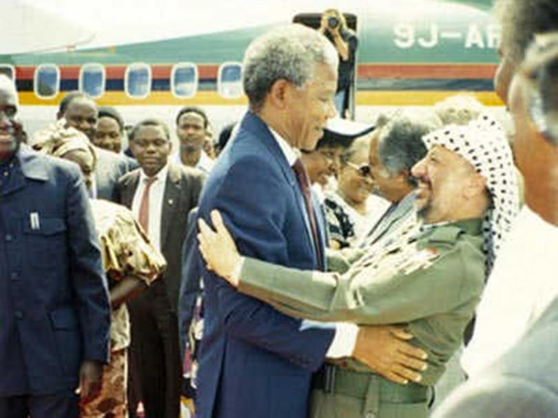 Nelson Mandela greeting Yassar Arafat in 1994.